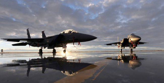 14760-two-f-15e-fighter-jets-on-a-runway-at-sunset-pv